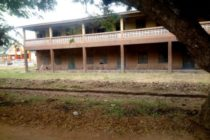 Danger looms; pupils use sinking building as classrooms