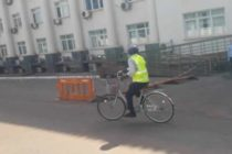 MP rides bicycle to Parliament in protest of high cost of fuel