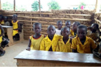 4 pupils share one desk at Dampong Faith School