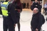 UK Police Arrest A Nigerian woman For Turning a White Man into Her Pet(Photo)