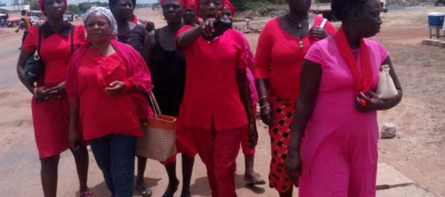 Ada women go 'Red Friday' in fight against Atsiakpo