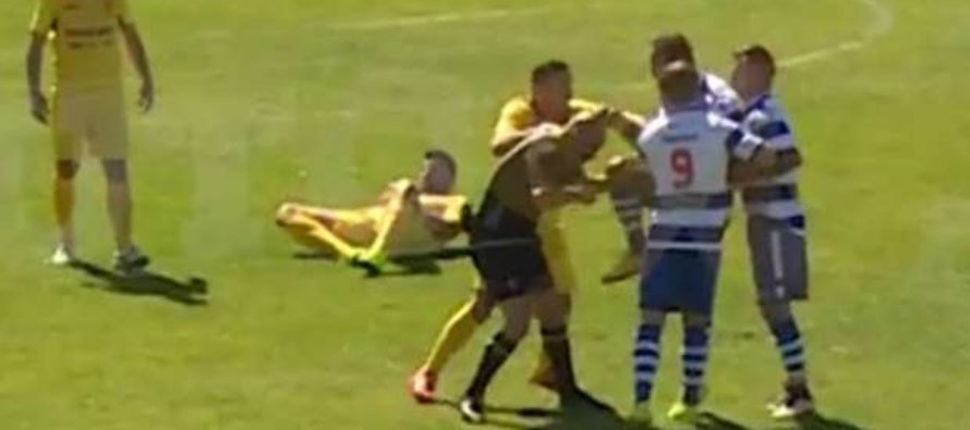 Striker banned after kneeing referee in face