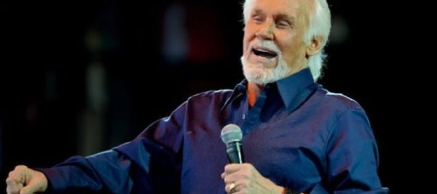 Kenny Rogers prepares to hang up his microphone