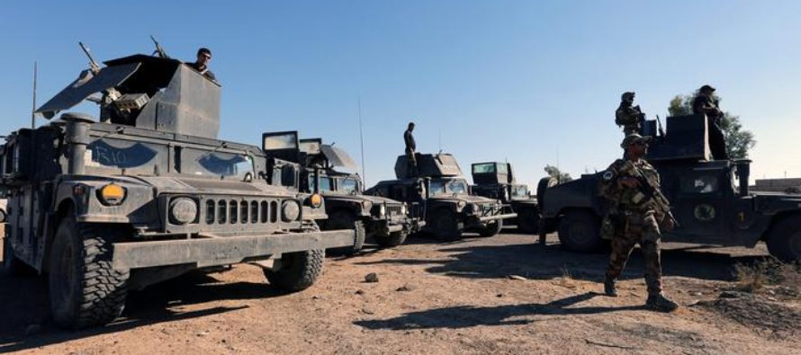 Iraq says troops recaptured key border crossing from 'Islamic State'