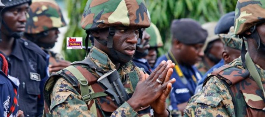 Photo of the week: A soldier's prayer before galamsey crackdown