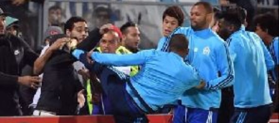 Evra given seven-month ban by Uefa for kicking supporter