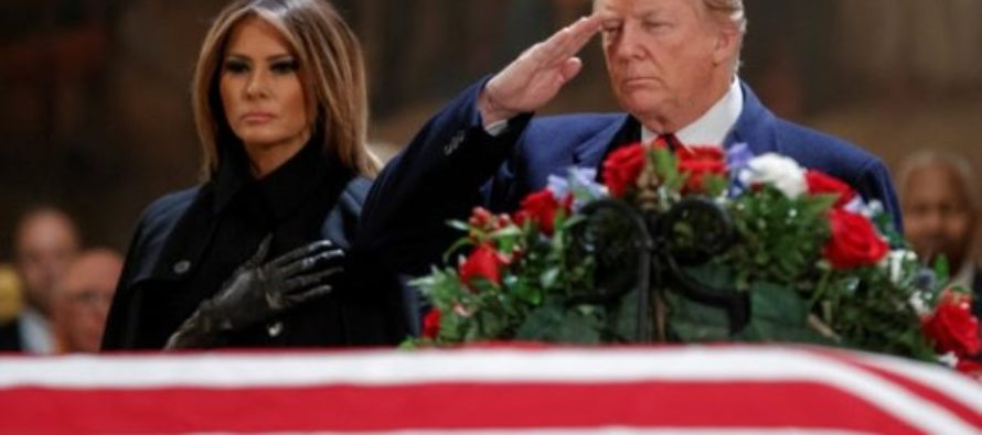 Trump pays respects as Bush lies in state