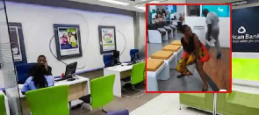 Angry woman urinates in the middle of a banking hall