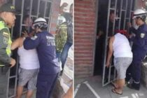 Woman sticks her head through neighbor's metal grate, gets stuck for five hours