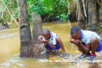 Photo: Agona Nyakrom Pupils drinking from dirty river