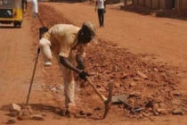 Physically challenged digs ground for road construction