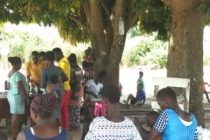OTI | Nursing Mothers Access Child Welfare Clinic Under Tree