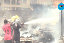 Agbogba residents join firefighters with buckets of water to douse fire
