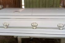 Police retrieves stolen coffin from burial service